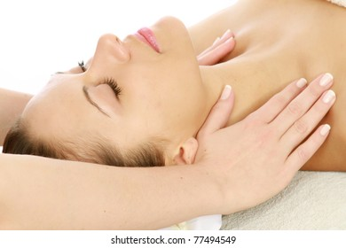 An attractive woman getting spa treatment, side-view