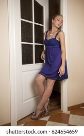 attractive woman go out of door in evening dress
