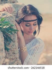 Attractive woman in greek style portrait