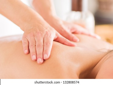 Attractive Woman Having A Massage With Massage Oil In A Spa