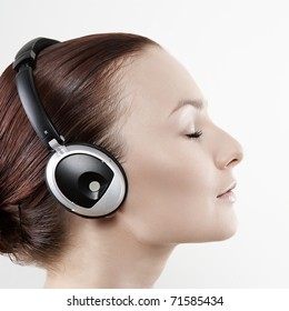 Attractive woman with headphones on white background
