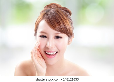 attractive woman with health skin and teeth, she is happy talk to you with nature green background, asian model
