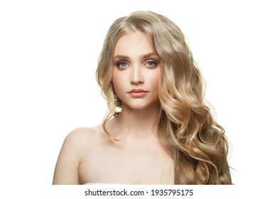 Attractive woman with healthy curly blonde hair and clear skin isolated on white background