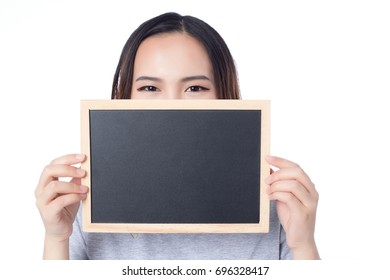 Attractive woman holding a chalkboard isolated on white background