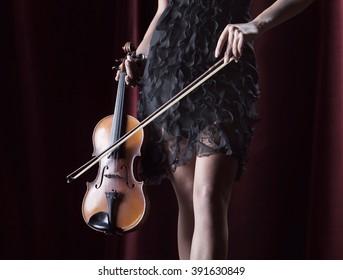 Attractive woman holding violin