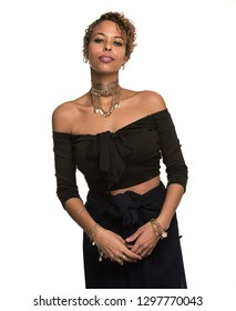 Attractive Woman Isolated on White in a Black Outfit and Gold Chocker Necklace