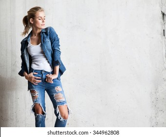 Attractive woman in jeans with blond hair