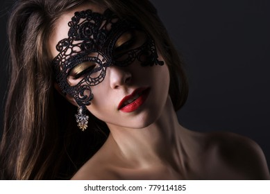 Attractive woman in lace mask. Portrait