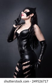 attractive woman in leather latex cat costume
