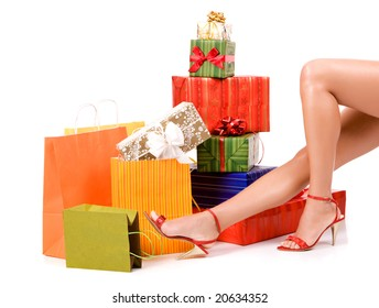 Attractive woman legs with many colorful gift boxes.
