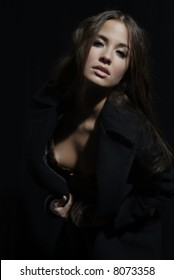 an attractive woman with long brown hair and coat
