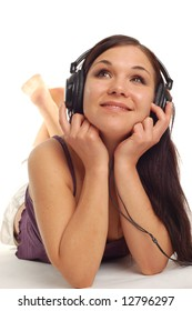 attractive woman lying with headphones