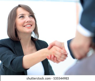 An attractive woman and man business team shaking hands at offic