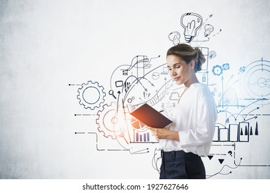 Attractive woman manager standing near business strategy plan on concrete wall, doodles and icons sketch set in office. Business finance chart graph, success achievement.