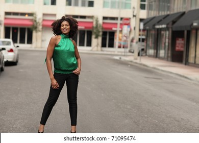 Attractive woman in the middle of the city street