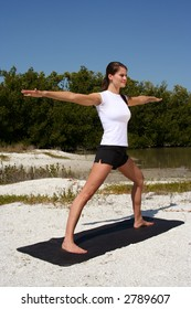 Attractive woman on beach doing yoga poses