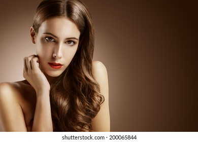 attractive woman on deep chocolate background