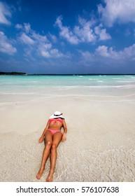 Attractive woman on a sandbank in the Maldives