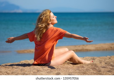 Attractive woman on a seacoast