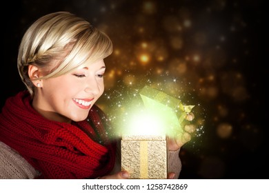 attractive woman opening a magical gift