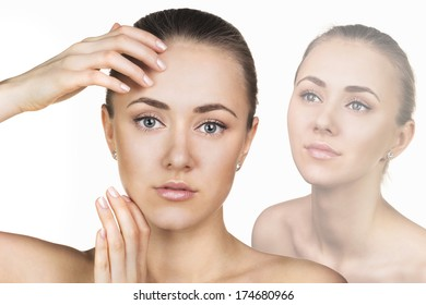 Attractive woman pampering her  face by beauty slender fingers