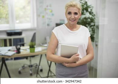 Attractive woman posing with a digital tablet