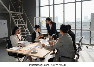 attractive woman present her analysis to young lady team leader  in business meeting with diversity people at modern office room, young power, woman leadership concept
