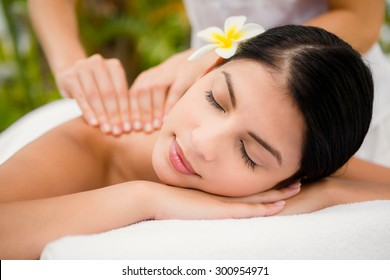 Attractive woman receiving back massage at spa center