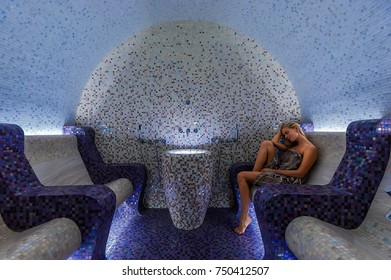 Attractive woman relaxing in a hammam - turkish steam bath