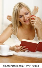 attractive woman relaxing at home reading a book