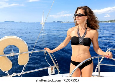 Attractive woman sails on the Mediterranean Sea, Croatia