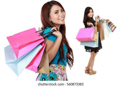 attractive woman with shopping bag. her friends at the background