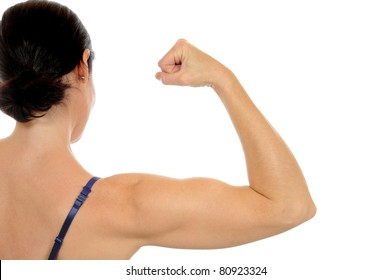 An attractive woman shows her muscles