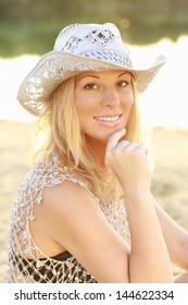 Attractive woman with silver cowboy hat