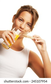 Attractive woman sipping orange juice