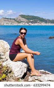 Attractive woman sitting on the rock - Zakynthos, Greece