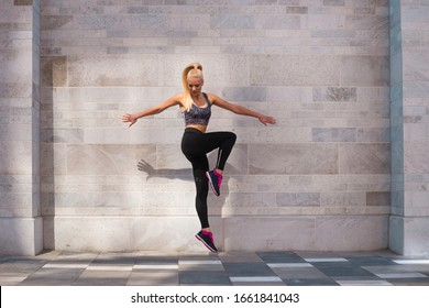 Attractive woman in sportswear training outdoor. Sport, jogging, healthy and active lifestyle.