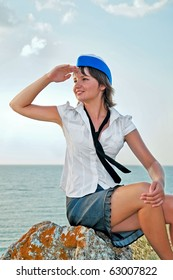 attractive woman stewardess looks into the distance