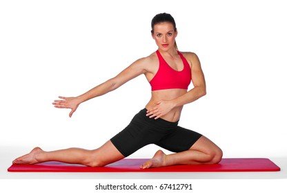 attractive woman stretching on the mat