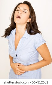 Attractive woman suffering from stomachache