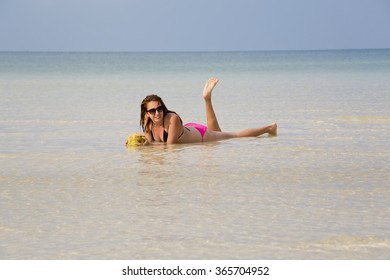 attractive woman sunbathing in gorgeous crystal water, cambodia