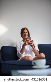Attractive woman texting on a mobile phone.