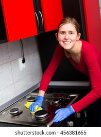 Attractive woman with toothy smile making clarity in her womanish kitchen.