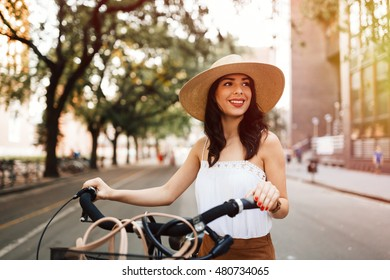 Attractive woman using bicycle as means of transportation