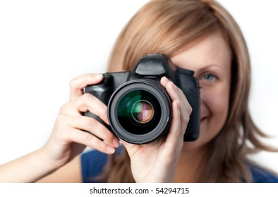 Attractive woman using a camera against a white background