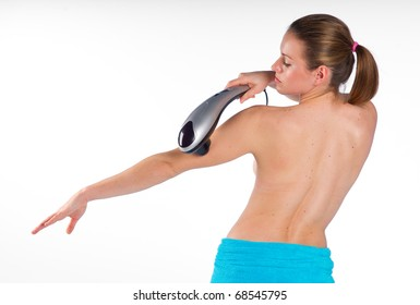 attractive woman using electric massager