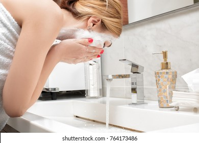 attractive woman to wash in bathroom after applying mask