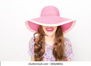 Attractive woman wearing big pink hat. focus on lips and hair