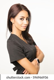 Attractive woman wearing scrubs for role in multiple career choices such as  beautician or care giver.