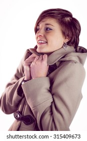 Attractive woman wearing a warm coat and smiling